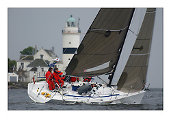 Yachting- The first days racing  of the Bell Lawrie Scottish series 2003 at Gourock.  The wet start looks set to last for the overnight race to Tarbert...Dave Ovington in his Mumm 30  'Ovington Boats' ..Pics Marc Turner / PFM