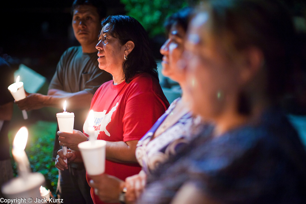 """Sept. 19 - PHOENIX, AZ: People gather for a candlelight vigil in support of the DREAM Act in front Sen. John McCain's office in Phoenix Sunday night. About 30 people met in front of US Sen. John McCain's office in Phoenix Sunday night to demonstrate in support of the DREAM Act, which is scheduled to be debated in the US Senate on Tuesday, Sept 21. The Development, Relief and Education for Alien Minors Act (The """"DREAM Act"""") is a piece of proposed federal legislation in the United States that was introduced in the United States Senate, and the United States House of Representatives on March 26, 2009. This bill would provide certain illegal immigrant students who graduate from US high schools, who are of good moral character, arrived in the U.S. as minors, and have been in the country continuously for at least five years prior to the bill's enactment, the opportunity to earn conditional permanent residency. In the early part of this decade McCain supported legislation similar to the DREAM Act, but his position on immigration has hardened in the last two years and he no longer supports it. The protesters, mostly area students, marched and drilled to show their support for the US military and then held a candle light vigil.   Photo by Jack Kurtz"""