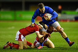 Federico Mori of Italy is tackled by Dafydd Buckland of Wales <br /> <br /> Photographer Craig Thomas/Replay Images<br /> <br /> U20 Six Nations - Wales v Italy  - Friday 31st January 2020 - Stadiwm Zip World (Parc Eirias) - Colwyn Bay<br /> <br /> World Copyright © Replay Images . All rights reserved. info@replayimages.co.uk - http://replayimages.co.uk