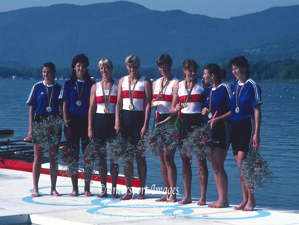 Banyoles, SPAIN, CENTRE; German Women's Quadruple Sculls, GER W4X, Gold Medalist. Kerstin MUELLER , Kristina MUNDT - RICHTER , Birgit PETER , Sybille SCHMIDT. POSE WITH THEIR MEDALS, FLANKED BY THE ROMAINAN WOMEN'S QUAD CREW; Constanta BURCICA , Veronica COCHELA - COGEANU , Anisoara BALAN - DOBRE , Doina IGNAT  1992 Olympic Regatta, Lake Banyoles, Barcelona, SPAIN.    [Mandatory Credit: Peter Spurrier: Intersport Images]