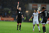 Michel Vorm, the Swansea city keeper is sent off by ref Mike Dean after he fouls Cardiff's Fraizer Campbell . Barclays Premier League match, Cardiff city v Swansea city at the Cardiff city stadium in Cardiff, South Wales on Sunday 3rd Nov 2013. pic by Andrew Orchard, Andrew Orchard sports photography,