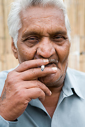 Portrait of an older man smoking a cigarette,