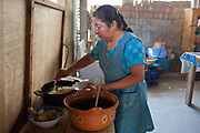 Mexican woman making traditional food. Oaxaca is known throughout Mexico and internationally for it's great food. Seen as a centre for Mexican cuisine, among other regional specialities the dish the area is best known for is called Mole.