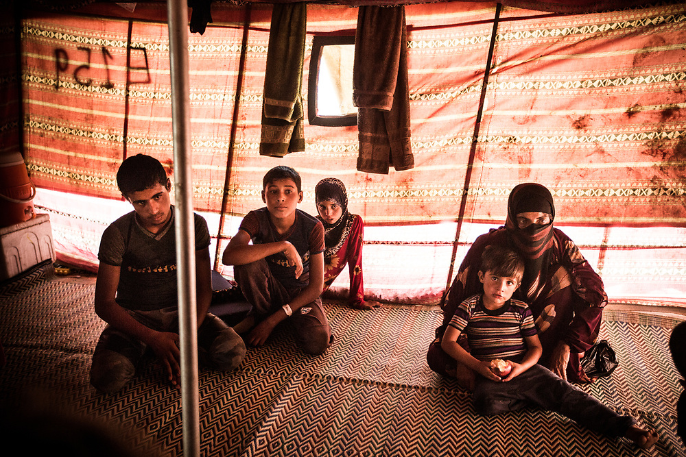Leyra(47), a mother of four kids, are seen with her children in a temporary tent in a refugee camp near West Mosul. Her husband belongs to IS and they don't even know if their father is still alive. When Iraqi army start approaching the old city of Mosul, her husband let them escape but he decided to stay and keep fighting against the army.