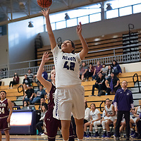 Amaya Smith (42) of Miyamura tries for a layup near the post against Belen in Gallup on Saturday. The Lady Patriots won 63-34.