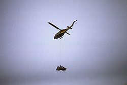 North Slope Borough Rescue Helicopter With Load During Rescue From Broken Off Floating Ice Sheet