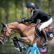 NORTH SALEM, NEW YORK - May 15: Stephen Moore, Ireland, riding Team De Coquerie, in action during The $50,000 Old Salem Farm Grand Prix presented by The Kincade Group at the Old Salem Farm Spring Horse Show on May 15, 2016 in North Salem. (Photo by Tim Clayton/Corbis via Getty Images)