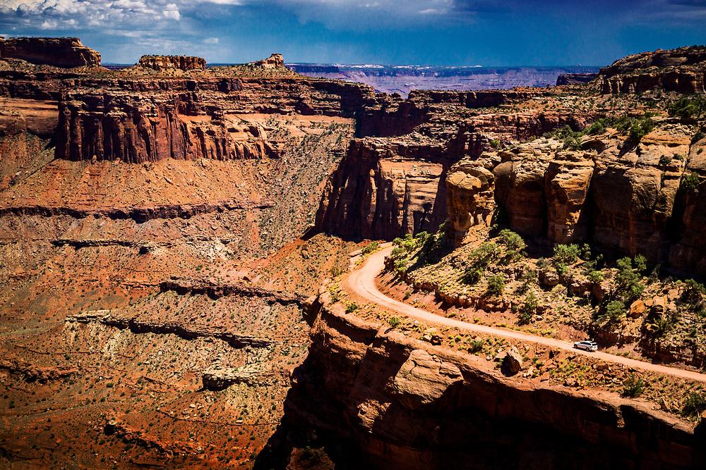Car driving in River Carved Valley in Canyonlands National Park in Moab, Utah. ©justinalexanderbartels.com