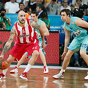 Olympiacos's Pero Antic (L) and FC Barcelona Regal's Erazem Lorbek (R) during their Euroleague Final Four semifinal Game 2 basketball match Olympiacos's between FC Barcelona Regal at the Sinan Erdem Arena in Istanbul at Turkey on Friday, May, 11, 2012. Photo by TURKPIX