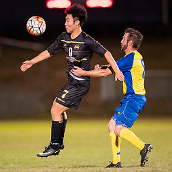 BRISBANE, AUSTRALIA - AUGUST 26: Kyusub Bang of Moreton Bay and Michael Angus of the Strikers compete for the ball during the NPL Queensland Senior Men's Semi Final match between Brisbane Strikers and Moreton Bay Jets at Perry Park on August 26, 2017 in Brisbane, Australia. (Photo by Patrick Kearney)
