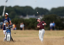 Northern Ireland's Rory McIlroy chips from the rough on the 4th during day three of The Open Championship 2018 at Carnoustie Golf Links, Angus.