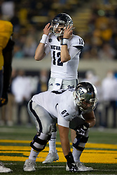 Nevada quarterback Carson Strong (12) calls an audible at the line of scrimmage during the second quarter of an NCAA college football game against California, Saturday, Sept. 4, 2021, in Berkeley, Calif. (AP Photo/D. Ross Cameron)