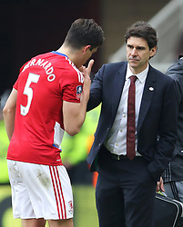 Middlesbrough's Bernardo Espinosa speaks with manager Aitor Karanka as he leaves the pitch after picking up an injury