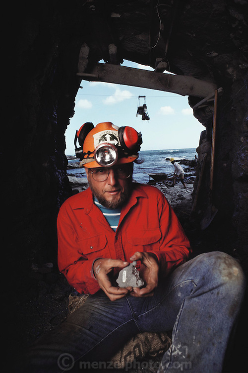 Paleontologist Tom Rich hold fossil skull of leaellynosaurus (named for Leaellyn Rich) in the mine tunnel where it was found at Dinosaur Cove, Cape Otway, southern Australia. Dinosaur Cove is the world's first mine developed specifically for paleontology ?normally the scientists rely on commercial mining to make the excavations. The site is of particular interest as the fossils found date from about 100 million years ago, when Australia was much closer to the South Pole than today. MODEL RELEASED [1989]