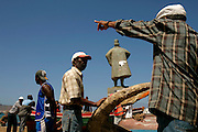 Next to  Belem's Tower replica and the statue of the explorer Diogo Afonso, fishermen from Mindelo fix the nets, talk, play cards or unload the fish for the market.