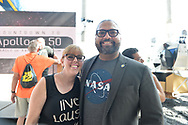 Garden City, New York, U.S. July 20, 2019. At right, New York State Senator KEVIN THOMAS poses for photo with woman he used to intern for, at the Moon Fest Apollo at 50 Countdown Celebration at Cradle of Aviation Museum in Long Island, held during the same time Apollo 11 Lunar Module landed on the Moon 50 years ago.