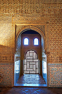 """Arabesque Moorish architectural details of the Palacios Nazaries Alhambra. Granada, Andalusia, Spain. . The Alhambra is a palace and fortress complex located in Granada, Andalusia, Spain. It was originally constructed as a small fortress in 889 CE on the remains of ancient Roman fortifications. The Alhambra was renovated and rebuilt in the mid-13th century by the Arab Nasrid emir Mohammed ben Al-Ahmar of the Emirate of Granada, who built its current Alhambra palace and walls. The Alhambra was converted into a royal palace in 1333 by Yusuf I, Sultan of Granada. The decoration of The Alhambra consists for the upper part of the walls, as a rule, of Arabic inscriptions—mostly poems by Ibn Zamrak and others praising the palace—that are manipulated into geometrical patterns with vegetal background set onto an arabesque setting (""""Ataurique""""). Much of this ornament is carved stucco (plaster) rather than stone. Tile mosaics (""""alicatado"""") of The Alhambra, with complicated mathematical patterns (""""tracería"""", most precisely """"lacería""""), are largely used as panelling for the lower part. .<br /> <br /> Visit our SPAIN HISTORIC PLACXES PHOTO COLLECTIONS for more photos to download or buy as wall art prints https://funkystock.photoshelter.com/gallery-collection/Pictures-Images-of-Spain-Spanish-Historical-Archaeology-Sites-Museum-Antiquities/C0000EUVhLC3Nbgw <br /> .<br /> Visit our ISLAMIC HISTORICAL PLACES PHOTO COLLECTIONS for more photos to download or buy as wall art prints https://funkystock.photoshelter.com/gallery-collection/Islam-Islamic-Historic-Places-Architecture-Pictures-Images-of/C0000n7SGOHt9XWI"""