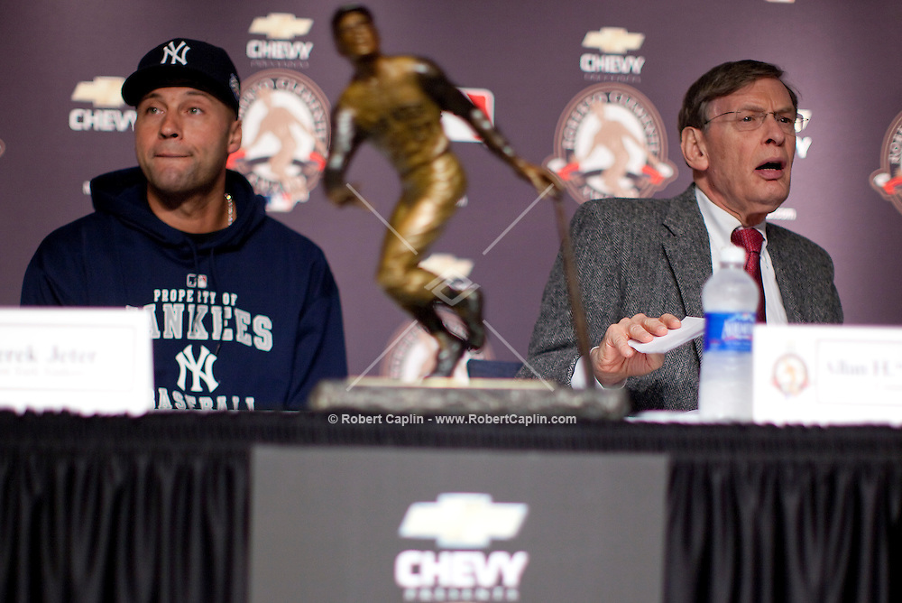 Derek Jeter is presented with the 2009 Roberto Clemente Award by MLB commissioner Bud Selig and Vera  Clemente prior to Game 2 of the 2009 World Series between the New York Yankees and The Philadelphia Phillies in Bronx, NY. (Photo by Robert Caplin)..