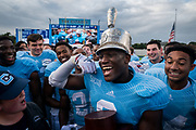 The Citadel linebacker Brian Horn flexes while wearing the Silver Shako trophy after defeating Virginia Military Institute in a Southern Conference game at Johnson Hagood Stadium in Charleston, South Carolina on Saturday, October 2, 2021.<br /> <br /> Credit: Cameron Pollack / The Citadel Athletics