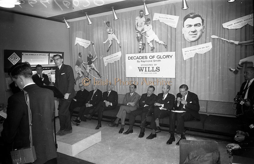 "17/05/1966<br /> 05/17/1966<br /> 17 May 1966<br /> Book reception for ""Decades of Glory: A Comprehensive History of the National Game"" by Raymond Smith.<br /> This reception was held in the offices of W.D. & H.O. Wills to honour the well known author and journalist, Raymond Smith. His book on the history of Hurling (""Decades of Glory"") has just been published with the assistance of Wills of Dublin and Cork and the Central Council of the G.A.A.<br /> Author, Raymond Smith speaking at the reception for his new book, ""Decades of Glory: A Comprehensive History of the National Game."""