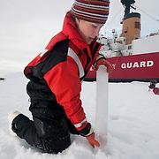 Mette Kaufman pulls up an ice core sample. Arctic Ocean