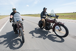 1916 Indian riding Oregonians Clint Funderburg (L) and Rich Rau head down the highway during the Motorcycle Cannonball Race of the Century. Stage-8 from Wichita, KS to Dodge City, KS. USA. Saturday September 17, 2016. Photography ©2016 Michael Lichter.