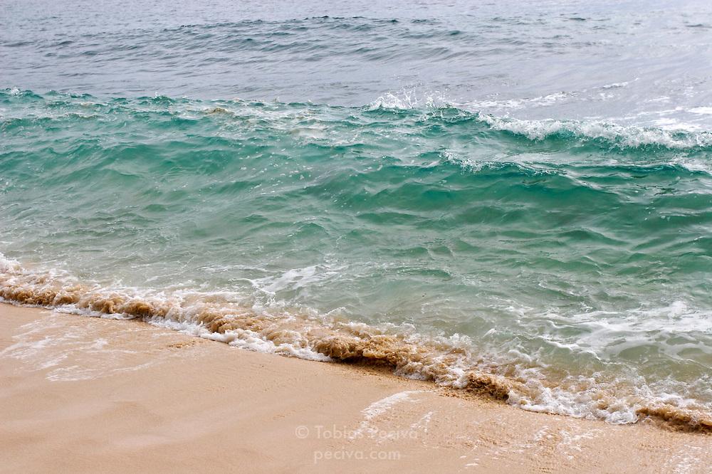 A small wave breaks onto the beach on Waya Island. Waya is part of the Yasawa Islands, on the western side of Fiji.