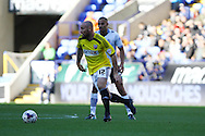 Brentfords' Alan McCormack goes past Bolton Wanderers' Darren Pratley. Skybet football league championship match, Bolton Wanderers v Brentford at the Macron stadium in Bolton, Lancs on Saturday 25th October 2014.<br /> pic by Chris Stading, Andrew Orchard sports photography.
