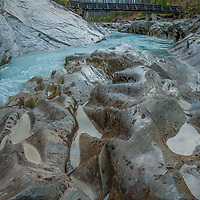The Vermillion River flows between eroded rocks in Kootenay National Park, British Columbia, Canada.