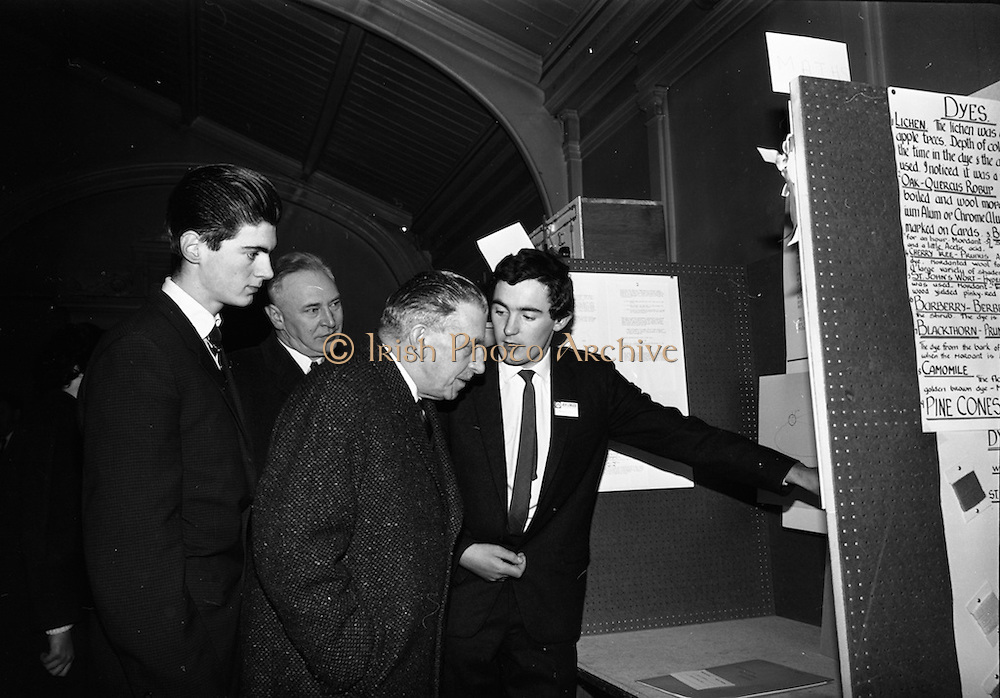 05/01/1965.01/05/1965.5th January 1965.The Aer Lingus Young Scientist Exhibition at the .Manson House,..Oliver Mc Bryan (U.C.D. Mathematical Science student) expLins his prizewinning project to An Taoiseach Sean Lemass and P.J. Lynch Chairman of Aer Lingus. Oliver was runner up to the Young Scientist of the year. Also in the picture is the winner John J. Monahan.