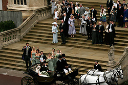 Peter Phillips and Canadian Autumn Kelly wave to wedding guests as they leave St. George's Chapel in Windsor after their marriage ceremony. Sang Tan/Anwar Hussein Collection/PA Photos