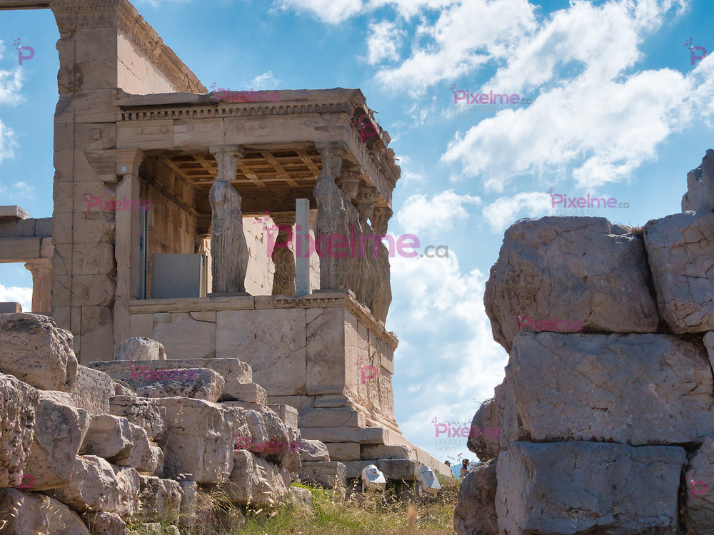 Athens, Greece - July 20, 2019 Detail of popular Athens sightseeing ancient temple Erechtheion in Acropolis opened for visiting by tourists against cloudy sky in Greece