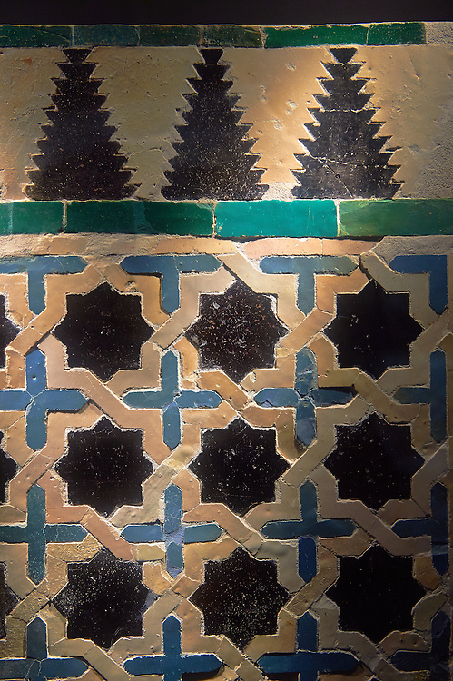 14th century Zellige tile panel from the Reala Alcazar of Seville in the time of Peter I of Castile. Seville Alcazar Museum, Seville. . The Royal Alcázars of Seville (al-Qasr al-Muriq ) or Alcázar of Seville, is a royal palace in Seville, Spain. It was built by Castilian Christians on the site of an Abbadid Muslim alcazar, or residential fortress.The fortress was destroyed after the Christian conquest of Seville The palace is a preeminent example of Mudéjar architecture in the Iberian Peninsula but features Gothic, Renaissance and Romanesque design elements from previous stages of construction. The upper storeys of the Alcázar are still occupied by the royal family when they are in Seville. <br /> <br /> Visit our SPAIN HISTORIC PLACES PHOTO COLLECTIONS for more photos to download or buy as wall art prints https://funkystock.photoshelter.com/gallery-collection/Pictures-Images-of-Spain-Spanish-Historical-Archaeology-Sites-Museum-Antiquities/C0000EUVhLC3Nbgw <br /> .<br /> Visit our MEDIEVAL PHOTO COLLECTIONS for more   photos  to download or buy as prints https://funkystock.photoshelter.com/gallery-collection/Medieval-Middle-Ages-Historic-Places-Arcaeological-Sites-Pictures-Images-of/C0000B5ZA54_WD0s