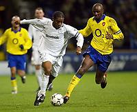Photo. Aidan Ellis.<br />Bolton Wanderers v Arsenal.<br />FA Barclaycard Premiership.<br />20/12/2003.<br />Bolton's Jay-Jay Okocha and Arsenal's Patrick Viera