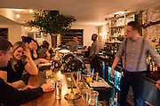 New York, NY, - December 8, 2013. Patrons sit at the bar at The Musket Room, 265 Elizabeth St.