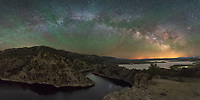 When I passed by this overlook of Seminoe Reservoir earlier in the evening I knew I had to return at midnight. As the milky way first rises it forms a huge arch from the northeast to southeastern sky. The only way to capture it all is by shooting a panorama with my widest lens. Stripes of green airglow crossed the sky and the yellow glow is light pollution from the Denver suburbs 150 miles away.