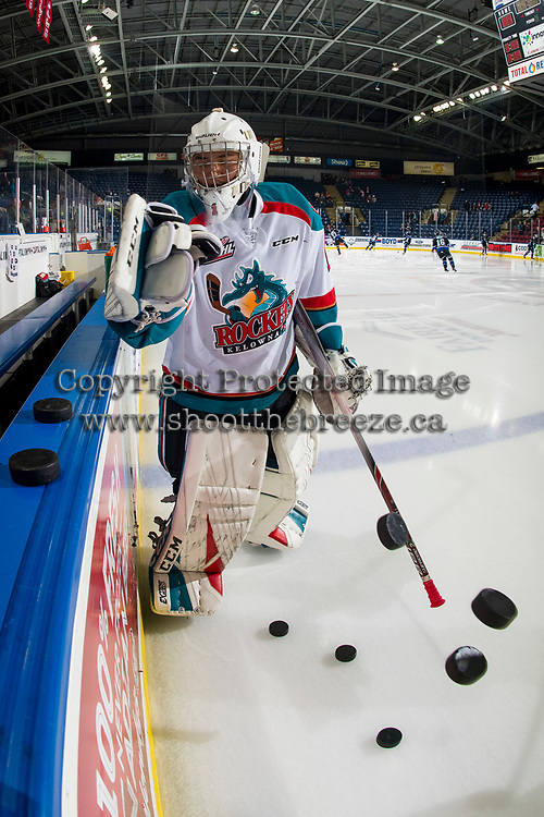 KELOWNA, CANADA - JANUARY 25: James Porter #1 of the Kelowna Rockets clears the pucks from the boards during warm up against the Victoria Royals on January 25, 2019 at Prospera Place in Kelowna, British Columbia, Canada.  (Photo by Marissa Baecker/Shoot the Breeze)