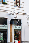 Pulling a rabbit out of a hat. A magic store sign in Vienna, Austria