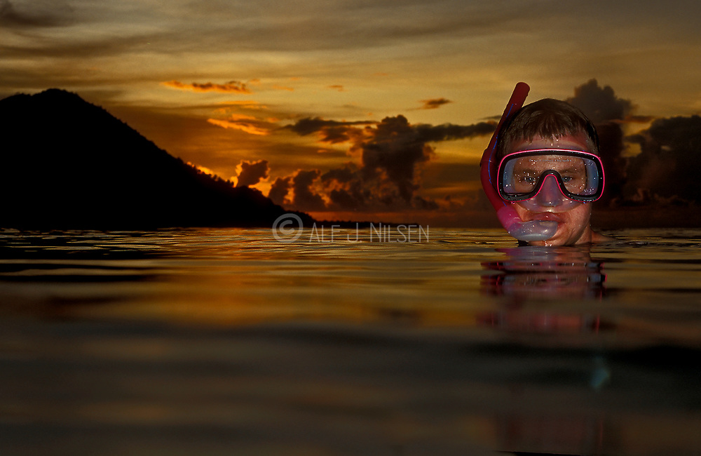 Skind diving during sunset in Indonesia.
