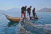 Semi-commercial fishing team deploying their net within the Lake Malawi National Park, Lake Malawi, Malawi.