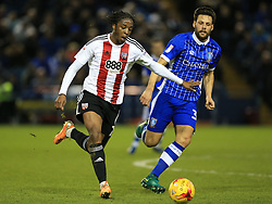 Sheffield Wednesday's Vincent Sasso (right) and Brentford's Romaine Sawyers battle for the ball