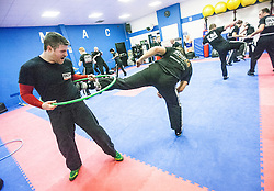 Students side-kicking and attacking under the area of the hoop, Stef Noij, KMG Instructor from the Institute Krav Maga Netherlands, at the IKMS G Level Programme seminar today at the Scottish Martial Arts Centre, Alloa.