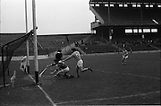 05/10/1969<br /> 10/05/1969<br /> 5 October 1969<br /> All-Ireland Junior (Home) Final: Kerry v Antrim at Croke Park, Dublin. <br /> Antrim full-back, J. Mulhalland, is just late with his tackle on Kerry's full-forward, J. Gannan (15), as he scores a goal for Kerry. The Antrim goalie failed to stop the ball.
