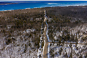 Winding road at the tip of the Door County, Wisconsin peninsula to the Northport Pier ferry dock.