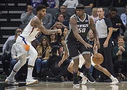 December 12, 2017 - Sacramento, CA, USA - The Phoenix Suns' Marquese Chriss (0) defends Sacramento Kings forward Zach Randolph (50) on Tuesday, Dec. 12, 2017, at the Golden 1 Center in Sacramento, Calif. (Credit Image: © Hector Amezcua/TNS via ZUMA Wire)