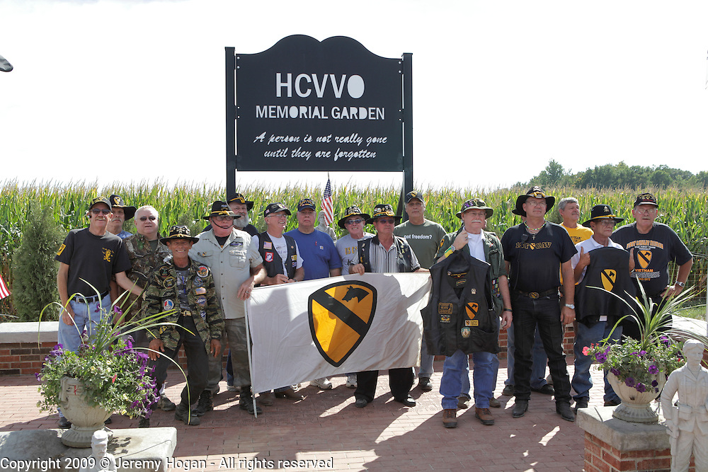 Vietnam Veterans of the 1st Cavalry Division gather for a group photo during the Vietnam Veterans gathering in Kokomo, Indiana for the 2009 reunion.