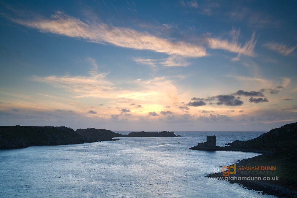 Evening skies over Cromwell's Castle, Tresco. Isles of Scilly, Cornwall, UK.