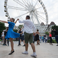 Revellers enjoy a social dance party at a public square after the COVID-19 restrictions were lifted by the government in downtown Budapest, Hungary on June 21, 2020. ATTILA VOLGYI