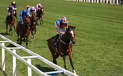 Jockey Ryan Moore on board Magic Wand (centre) wins the Ribblesdale Stakes during day three of Royal Ascot at Ascot Racecourse.