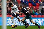 Delle Alli of Tottenham Hotspur (L) goes past Matt Targett of Southampton (R). Premier league match, Tottenham Hotspur v Southampton at Wembley Stadium in London on Boxing Day Tuesday 26th December 2017.<br /> pic by Steffan Bowen, Andrew Orchard sports photography.